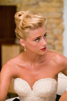 Loving Amber Heard's retro up-do.  Simply Stunning!