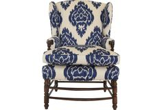 Antique wingback newly upholstered in navy & cream ikat chintz