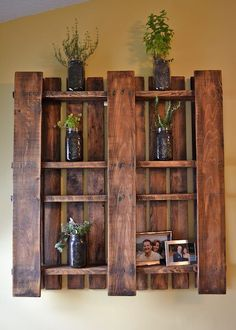 Sanded and finished wood pallets can make a beautiful shelf. Just another awesome repurposing idea.