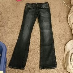 Dark Blue Jeans Gently used / in good condition. Tiny blemish on back of leg. Jeans