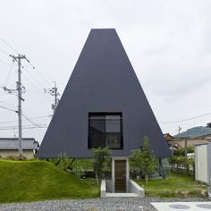 Here's the latest in our series of stories about projects by Japanese architects Suppose Design Office: a residence in Saijo, Hiroshima, Japan, based on traditional pit-dwelling houses. Earth excavated from the site was used to build a wall around the house, creating a room below ground level surrounded by glass but shielded from its neighbours.