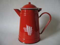Burnt orange and black enamel metal teapot wheat motif euro vintage hinged lid. $14,00 USD, via Etsy.