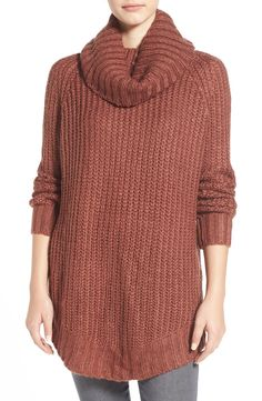 Cozy up in this oversized cowl-neck sweater styled with a chunky-knit construction and a drapey fit.