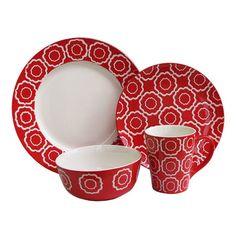 Sixteen-piece dinnerware set with trellis motifs.  Product: 4 Dinner plates 4 Salad plates4 Bowls