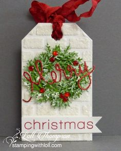 Stamping with Loll [exquisite tag with white heat embossed brick background and leafy punched wreath]