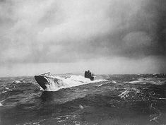 WW1: A German U-boat surfaces in rough seas in the North Atlantic. The serrated device on the bow was a cutter for anti-sub nets.