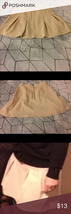 Forever 21 beige skirt size Forever 21 beige skirt size only worn once. Fits cute and can go with heels or flats. Skirts