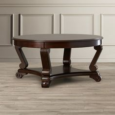 Found it at Wayfair - Culnafay Coffee Table $193 - not solid wood but great reviews, 42 inch diameter might be too big