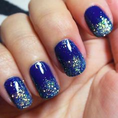 lovely nail art idea that can be easily done at home, royal blue nail polish topped with silver sparkles only at the tips,