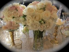 pale pink peony, pink, ivory, and champagne roses  http://loricurie.wordpress.com/2010/06/01/beautiful-weddings/