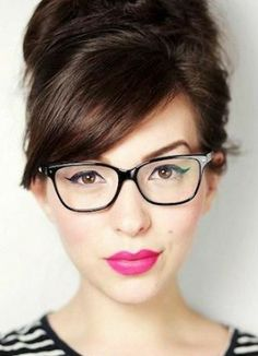 For a bolder look, sweep your bangs to the side of your face and pair with a bright pink lipstick.