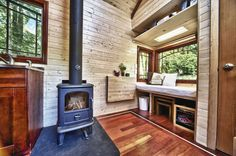 Window seat and wood burning stove - Candice's Tiny House @ the Tiny Tack House