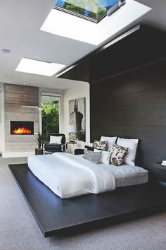 Master Bedroom With A Skylight | www.bocadolobo.com #modernfurniture #masterbedroomideas #designinspirations #fireplace