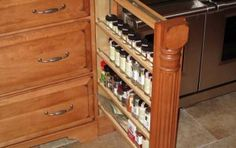 Stained Pull-Out Spice Rack with Column Detailing Pull Out Spice Rack, Contractors License, Custom Cabinetry, Palette, The Prestige, Entertainment Center, Wine Rack, Countertops, Bookcase