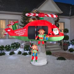 Bring holiday cheer to your yard with this animated inflatable scene. Santa's elves embark on a special mission with their helicopter to bring holiday cheer to your neighborhood. Plug it in, stake it down and watch the magic of this inflatable unfold. Christmas Lawn Decorations, Inflatable Christmas Decorations, Christmas Tree With Gifts, Christmas Elf, Paper Decorations, Holiday Decor, Disney Christmas Crafts, Outdoor Decorations, Christmas Stuff