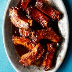 One reason these ribs are so impossibly good is that they're braised for hours and then deep-fried so they're supercrisp. The sauce—which includes k...