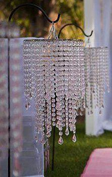 Shepherd hooks with hanging chandeliers