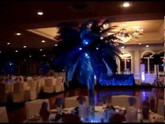 Ostrich feathers in Purple, Lavender & Royal Blue by Sweet 16 Candelabras.
