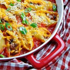 Taco Stuffed Shells Recipe : Jumbo pasta shells stuffed with a taco inspired mixture of beef, corn, black beans and goat cheese that is covered in cheese and baked in salsa. Pasta Recipes, Great Recipes, Dinner Recipes, Cooking Recipes, Favorite Recipes, Casserole Recipes, Yummy Recipes, Cooking Tips, Chili Relleno