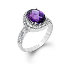 This lovely addition to our Blindingly Beautiful collection features a stunning 2.24 ctw amethyst surrounded by .27 ctw of white diamonds set in 14k white gold.