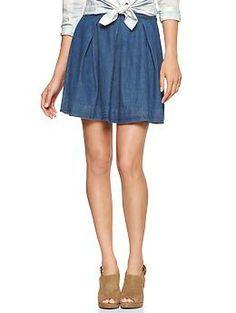 Pleated denim mini skirt with tied shirt