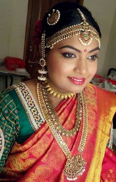 Traditional Southern Indian bride wearing bridal saree, jewellery and hairstyle. #BridalMakeup