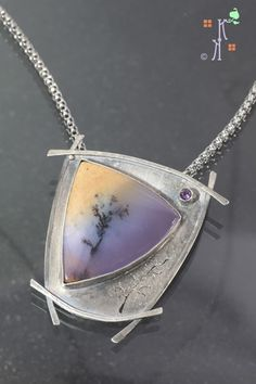 Still Standing.  A tribute to all who endured the Waldo Canyon fire.  From Kathleen Krucoff's Treescape series.  Amethyst sage, set in sterling silver, with an amethyst tube set.