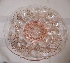 """This Pink """"Inverted Thistle"""" Pattern Egg Plate is 11 1/2″ in diameter. It is American Handmade Glass."""