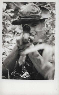 "Sylvester L. Hanna, Da Nang, Vietnam, 1968. ""Sighting In: Marine Corporal Sylvester L. Hanna, 19 (Chicago, Illinois), sights in his rifle during an operation south of Da Nang, Vietnam. Hanna is a sniper with 2d Battalion, 7th Marines [2/7] (official USMC photo by Corporal W. A. Oberg)."" From the Jonathan Abel Collection (COLL/3611), Marine Corps Archives & Special Collections. OFFICIAL USMC PHOTOGRAPH"