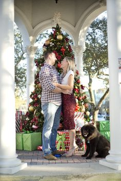 Christmas Mini Session by True Era Photography | San Marco Square | Jacksonville, Florida #christmas #photography #christmasphotos #christmastree #sanmarco #jacksonvillephotographer #jacksonville #floridachristmas #florida #couple #dog #family #portrait #christmasthemed