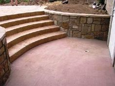 I like how the steps are incorporated into the retaining wall.  The curved walls and stairs work well together, could see this working in a terraced design