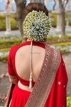 Is there any better combination than a classic red lehenga paired with a low bun hairstyle tucked with jasmine and baby's breath? We are in love with this elegant bridal look.  #Indianweddings #shaadisaga #indianbridalhairstyles #hairstyleswithflowers #intimatewedding #realflowers #uniquecolourlehenga #babybreaths #lowbun #jasmine #mogra #redlehenga  Bridal Hairstyle Indian Wedding, Bridal Hair Buns, Bridal Hairdo, Indian Wedding Hairstyles, Indian Bridal Fashion, Cute Bun Hairstyles, Wedding Bun Hairstyles, Lehenga Hairstyles, Mehndi Hairstyles
