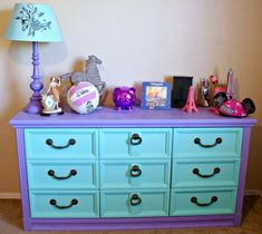 Love the colors on the dresser... would change out the drawer pulls though