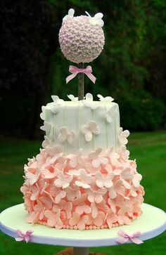 Pink Ombre Butterfly Cake - dont like the flower ball on top but the butterflies are great:)