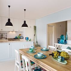 Splashes of the palest green to the deepest, darkest blue give you a fresh colour scheme you willingly dive into. #taubmanscolour #holidaymemory #kitchen  #beachhouse