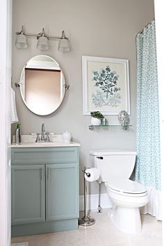 15 Incredible Small Bathroom Decorating Ideas - calming soft blue painted cabinets + matching patterned shower curtain