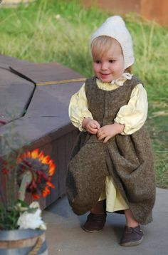 Simple Glee. Baby Peasant garb.  of things to come.  Love that we get to see the shoes too.