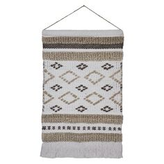 "• Made of woven cotton<br>• Measures 29.75 inches tall<br><br>The Woven Wall Hanging in Cream/Neutral (18""x31"") from Threshold is a smart way to warm up a wall. This wall art has a geometric design with fringe and looks good in a hallway or living space."