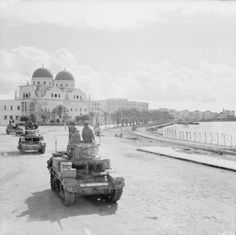 """""""British troops are invading Benghazi: chasing German Army as it flees from Egypt, Allies now capture key Libyan port. Benghazi Libya, Tank Warfare, North African Campaign, Afrika Korps, Ww2 Pictures, Free In French, Army Vehicles, Military Equipment, German Army"""