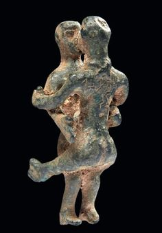 South Arabian bronze couple in a lovemaking scene, 2nd-3rd century A.D. Inscribed with names, 9 cm high. Private collection