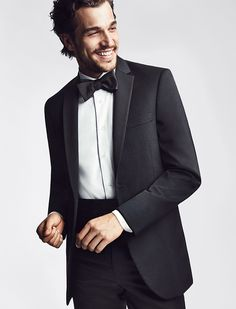 The classic black tux gets a modern update. From Men's Wearhouse.