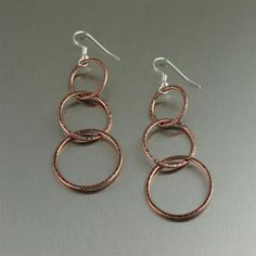 Dramatic Chased Copper Hoop Earrings Listed on #ILoveCopperJewelry #CopperAnniversary #BoHo https://www.ilovecopperjewelry.com/chased-copper-hoop-earrings-three-tiered.html