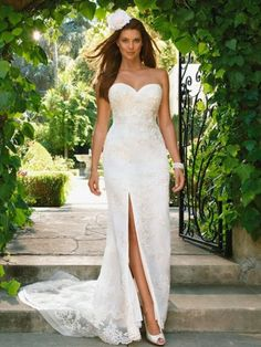 Casablanca 2022 strapless sweetheart neck Wedding Dress. This bridal dress in semi mermaid and has a high slit on one side which can be opened or closed with a zipper.