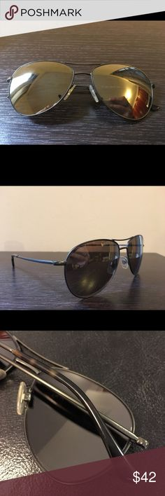 Polo Ralph Lauren Aviator Sunglasses Dark green frame with brown/silver mirror lenses color, metal frame, lightweight. NOTE: has minor scretch on one lense and bigger on the other (see photos). They are not noticeable when wearing the sunglasses. Polo by Ralph Lauren Accessories Sunglasses