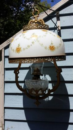Hanging Oil Lamp with hand painted milk glass shade. Available @ Valley Vintage & Antique Finds in North Conway, NH.