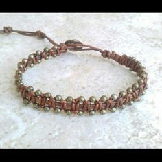 "Copper Mix Single Brown Leather Bracelet ITEM DESCRIPTION   Single Wrap Bracelet features Copper Metal beads Individually Handwoven Onto Strands of Brown Leather Cord. Measures approx 10""L.   TommyBee Engraved Button With 3 adjustable clousures.  *This Bracelet was Created, designed and Handcrafted by Me. I trully Appreciate your Support and Likes. Created for my Own Personal Collection on Etsy.com.  See my Creations at :  www.TommyBee.Etsy.com Tommy Bee Jewelry Bracelets"
