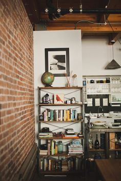 Cool bookshelf and shelf above sink