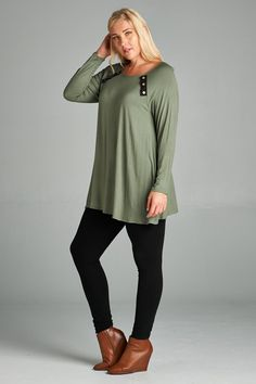 Solid jersey and rayon tunic top with suede and button trim detailing. Longer in length, great drape, soft and stretchy for comfort.