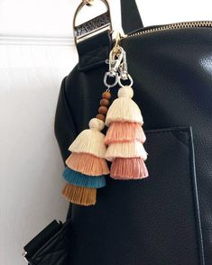 I love how the color combo turned out with all the wood beads! This keychain was made with thicker tassels and I love the result. Macbook Bag, Beaded Tassel Earrings, Tassel Keychain, Jewelry Box, Unique Jewelry, Cute Packaging, Gold Beads, Neutral Colors, Diaper Bag