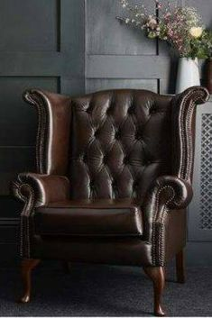 Dark, mean and moody. this is a traditional, high backed chair with classic Chesterfield features such as the deep buttoned back and scroll arms. It would look amazing as a statement chair in the living room, or even bedroom and is perfect with a traditional or eclectic decor. Made right here in the UK, the Queen Anne wing back chair is available from Darlings of Chelsea #wingbackchair #leatherchair #leatherarmchair